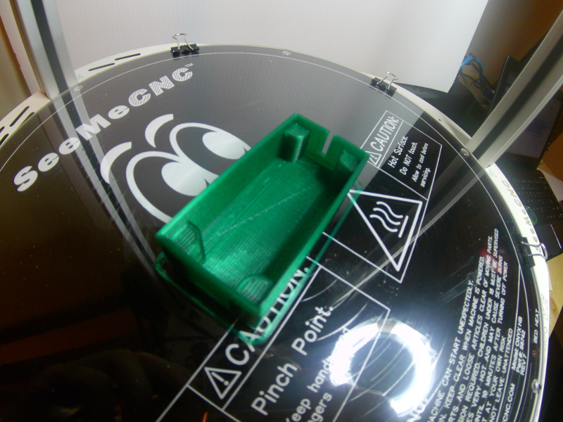 A picture of the printed speaker box in dark green plastic