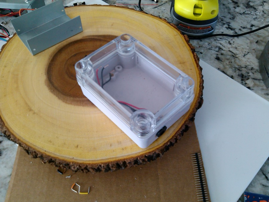 The control and electronics enclosures on the burl base